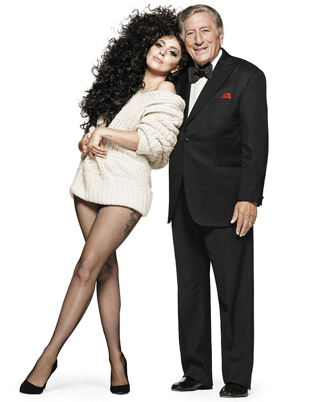 Look at those legs: Gaga shows off her impressive pins whilst posing with Tony is a promo shot for H&M