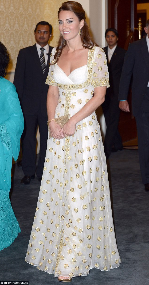 Regal elegance: In a cream and gold dress by favourite designer Alexander McQueen, Kate wowed guests on the 2012 Diamond Jubilee tour of Malaysia