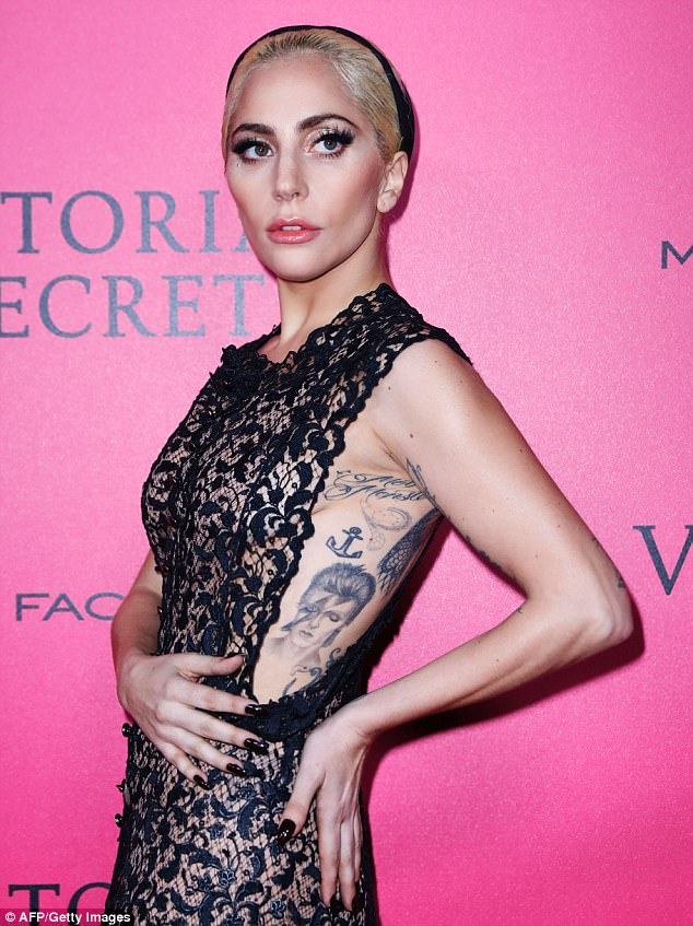 Tribute: Gaga later got matching tattoos with some of the young people at the performance, who had come on stage with slogans written on their arms such as Not At All Your Fault and Unbreakable