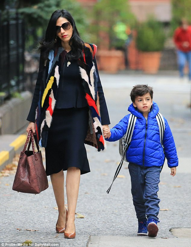 On the go: Huma Abedin was photographed taking her five-year-old son Jordan to school on Wednesday morning