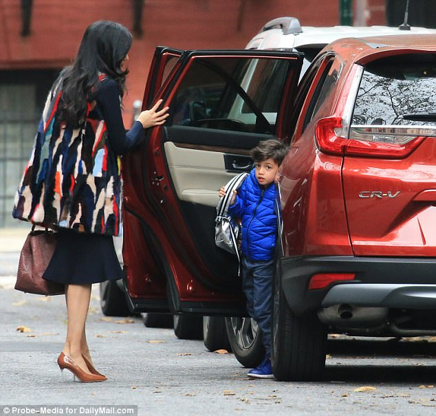 Starting the day: The longtime Hillary Clinton aide drove Jordan to school in her red SUV