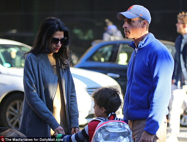 Focusing on their son: Abedin and Weiner were last pictured together in public on Halloween as they held hands with their son Jordan on the way to his school
