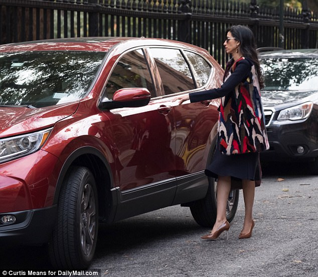 Taking off: Abedin returned to her red SUV and hopped in the driver
