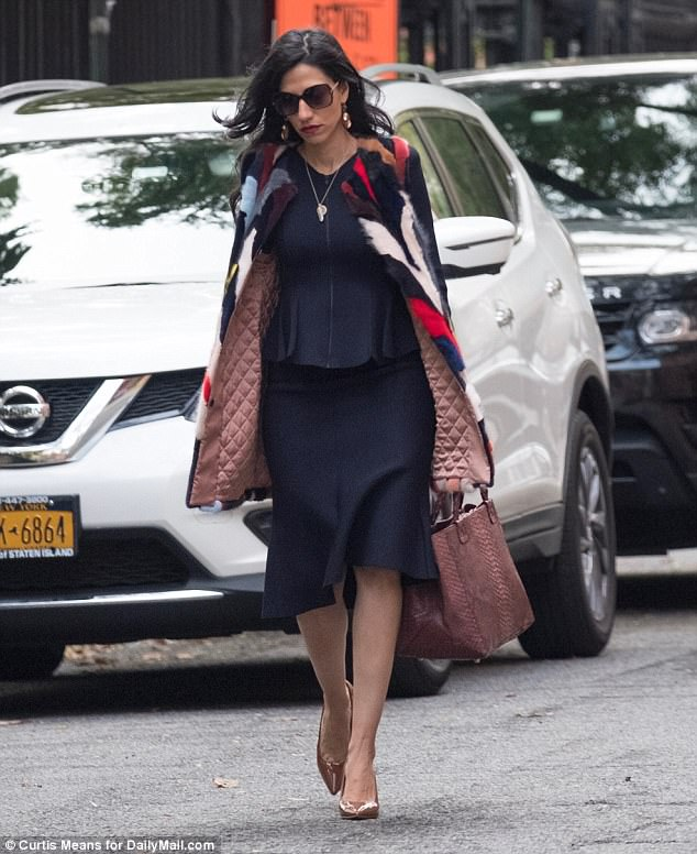 Next stop: After dropping Jordan off, Abedin was seen walking back to her SUV with her mink vest blowing in the wind