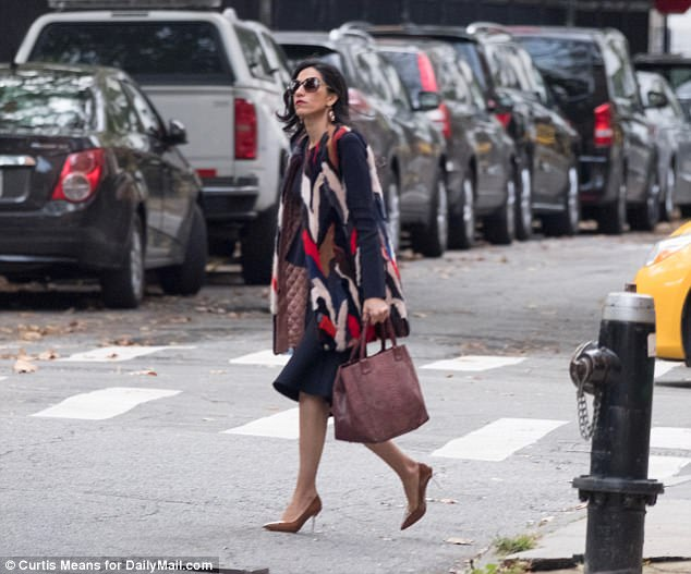 Almost there: Abedin crossed the street as she made her way back to her car